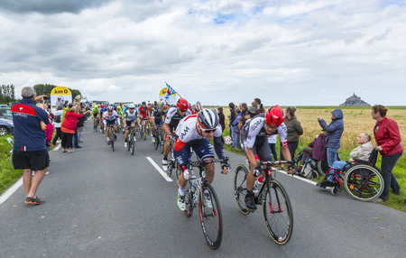 peloton: Ardevon, France - July 2, 2016: The peloton taking the start of Tour de France at Km 0, close to Mont Saint Michel Monastery, in Ardevon,France on July 2,2016.