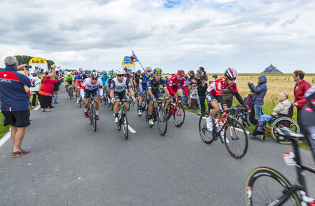 2 0: Ardevon, France - July 2, 2016: The peloton (including Mark Cavendish- the winner of the stage)  taking the start of Tour de France at Km 0, close to Mont Saint Michel Monastery, in Ardevon,France on July 2,2016. Editorial