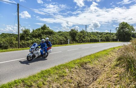 Quineville,France- July 2, 2016: Medical bike driving on the road during the first stage of Tour de France in Quineville, France on July 2, 2016. Editorial