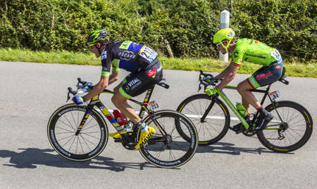 breakaway: Quineville,France- July 2, 2016: The cyclists Anthony Delaplace of Fortuneo-Vital Concept Team and Alex Howes of Cannondale-Drapac Team riding in the breakaway during the first stage of Tour de France in Quineville, France on July 2, 2016.