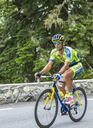 daniele: Col du Tourmalet, France - July 24,2014: The Italian cyclist Daniele Bennati of Tinkoff-Saxo Team climbing the difficult road to Col du Tourmalet in Pyrenees Mountains during the stage 18 of Le Tour de France 2014. Editorial