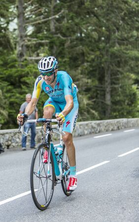 mountain bicycling: Col du Tourmalet, France - July 24,2014: The Italian cyclist Alessandro Vanotti of Astana Team climbing the difficult road to Col du Tourmalet in Pyrenees Mountains during the stage 18 of Le Tour de France 2014. Editorial