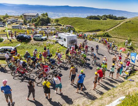 jura: Col du Grand Colombier,France - July 17, 2016: The peloton riding in a hairpin curve at Col du Grand Colombier in Jura Mountains during the stage 15 of Tour de France 2016.