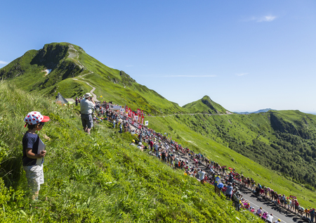 pas: Pas de Peyrol, France - July 6,2016: The peloton riding on the road to Pas de Pyerol (Puy Mary) in Cantal in the Central Massif during the stage 5 of Tour de France on July 6, 2016.