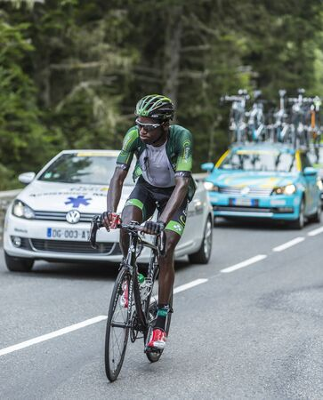 mountain bicycling: Col du Tourmalet, France - July 24,2014: The French cyclist Kevin Reza of Team Europcar climbing the difficult road to Col du Tourmalet in Pyrenees Mountains during the stage 18 of Le Tour de France 2014.