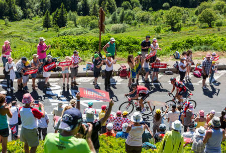 breakaway: Pas de Peyrol, France - July 6,2016: The cyclists Thomas De Gend of  Lotto-Soudal Team and Greg Van Avermaet of BMC Racing Team, in the breakaway, riding on the road to Pas de Pyerol (Puy Mary) in Cantal,in the Central Massif, during the stage 5 of Tour d
