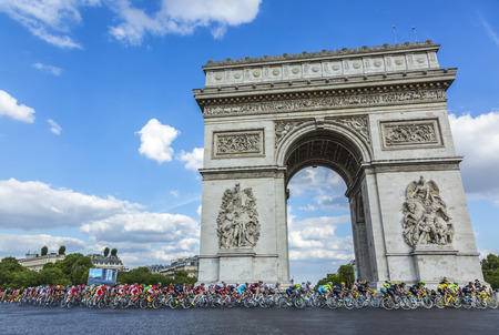 champs elysees: Paris, France - July 24, 2016: The peloton (including the major distinctive jerseys) passing by the Arch de Triomphe on Champs Elysees in Paris during the latest stage of Tour de France 2016. Editorial