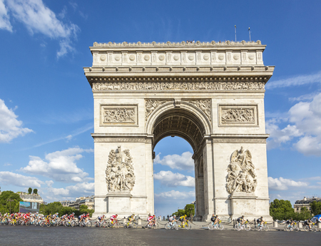 champs elysees: Paris, France - July 24, 2016: ChrissFroome of Team Sky wearing the Yellow Jersey passing by the Arch de Triomphe on Champs Elysees in Paris during the latest stage of Tour de France 2016. Editorial
