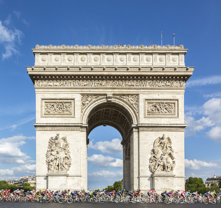 champs elysees: Paris, France - July 24, 2016: The peloton passing by the Arch de Triomphe on Champs Elysees in Paris during the latest stage of Tour de France 2016.