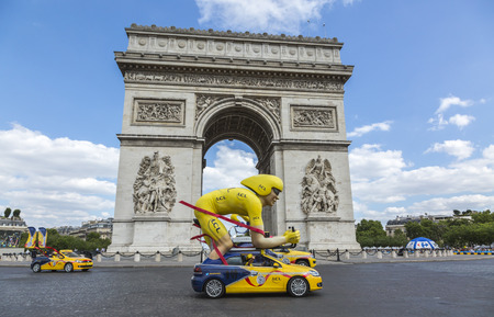 champs elysees: Paris, France - July 24, 2016: The speicific yellow cyclist mascot of LCL during the passing of The Publicity Caravan by the Arch de Triomphe on Champs Elysees in Paris during the latest stage of Tour de France 2016. Editorial