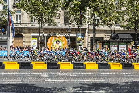peloton: Paris, France - July 24, 2016: The feminine peloton riding on Champs Elysees in Paris during the second edition of La Course by Le Tour de France 2016.