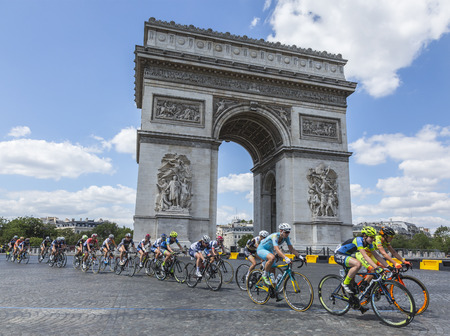 Paris, France - July 24, 2016: The feminine peloton riding by the Arch de Triomphe on Champs Elysees in Paris during the second edition of La Course by Le Tour de France 2016.