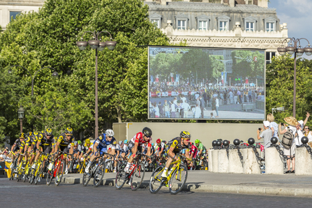 champs elysees: Paris, France - July 24, 2016: Thomas Voeckler of Direct Energie Team and Thomas De Gendt of Lotto-Soudal Team in fornt of the peloton passing by the Arch de Triomphe on Champs Elysees in Paris during the latest stage of Tour de France 2016.