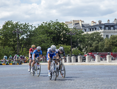 champs elysees: Paris, France - July 24, 2016: The feminine breakaway riding on Champs Elysees in Paris during the second edition of La Course by Le Tour de France 2016.