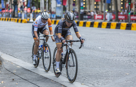 champs elysees: Paris, France - July 24, 2016: Two female cyclists, Amy Pieters of  Wiggle High5 Team and Lucinda Brand of Raboliv Women Cycling Team, riding on Champs Elysees in Paris during the second edition of La Course by Le Tour de France 2016.