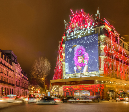 Paris,France- December 21, 2014: Night aspect of Galleries Lafayette and The Haussmann Boulevard decorated for winter holidays in Paris on December 21, 2015.