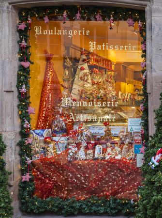 boulangerie: Colmar,France- December 6,2013: A window of a trraditional Alsatian bakery is festive decorated during the wihter holidays season.