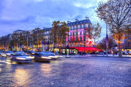 champs elysees: Paris,France - 27 November 2016: Dusk image of the famous Champs Elysees Boulevard in Paris festive decorated during the winter holidays. Editorial