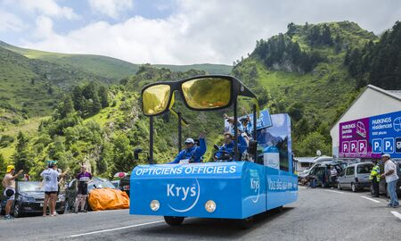 Col du Tourmalet, France - July 24,2014: Krys caravan during the passing of the Publicity Caravan on the road to Col de Tourmalet in the stage 18 of Le Tour de France 2014.Before the appearance of the cyclists there is a caravan of advertising cars of the