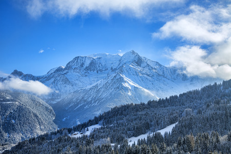 blanc: Beautiful winter landscape with Mont Blanc Massif in the distance. Stock Photo