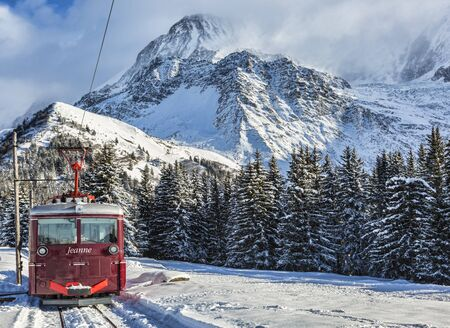 Col de Voza, France - December 30,2014: TheTramway du Mont Blanc reaches the railway station in Col de Voza on 30 December 2014. This is the highest tram in France connecting Saint Gervais with Nid dAigle station at the Bionnassay glacier. Editorial