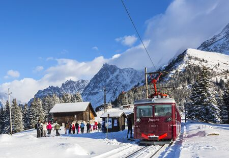 reaches: Col de Voza, France - December 30,2014: TheTramway du Mont Blanc reaches the railway station on Col de Voza on 30 December 2014. This is the highest tram in France connecting Saint Gervais with Nid dAigle station at the Bionnassay glacier. Editorial