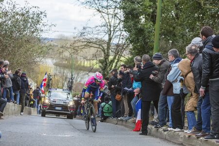 Conflans-Sainte-Honorine,France-March 6,2016: The Italian cyclist Matteo Bono of Lampre-Merida Team riding during the prologue stage of Paris-Nice 2016.