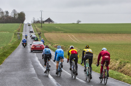 Chateau-Renard,France - March 06,2017: Five cyclists in the breakaway (Tony Galopin of Lotto Soudal, Evaldas Siskevicius of Delko Marseille Provence KTM,Sven Erik Bystrom of Katusha Alpecin,Maartin Wynants of Lotto NL-Jumabo,Philippe Gilbert of Quick-Step