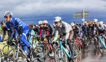 ville: Cernay-la-Ville, France - March 5, 2017: Alberto Contador of Trek Segafredo Team, surrounded by other big favourites inside the peloton, riding on a wet road during the first stage of Paris-Nice on 5 March, 2017. Editorial