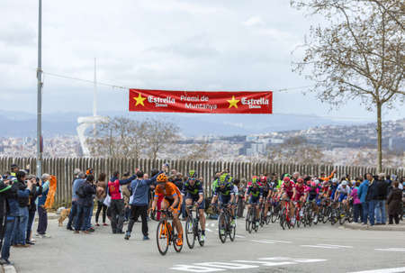 peloton: Barcelona, Spain - March27, 2016: The peloton riding during Volta Ciclista a Catalunya, on the top of Montjuic in Bracelona Spain, on March 27, 2016. Editorial