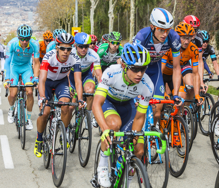 gomez: Barcelona, Spain - March27, 2016: The Colombian cyclist Jarlinson Pantano of Team IAM, riding in the peloton, on the road to the top of Montjuic in Bracelona Spain, during Volta Ciclista a Catalunya, on March 27, 2016.