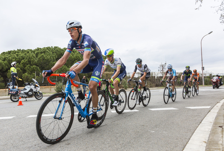 peloton: Barcelona, Spain - March27, 2016: The peloton riding during Volta Ciclista a Catalunya, on the road to the top of Montjuic in Bracelona Spain, on March 27, 2016. Editorial