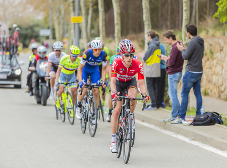 montjuic: Barcelona, Spain - March27, 2016: The peloton riding during Volta Ciclista a Catalunya, on the road to the top of Montjuic in Bracelona Spain, on March 27, 2016. Editorial