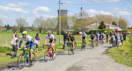peloton: Hornaing ,France - April 10,2016: The peloton riding on a paved road in Hornaing, France during Paris Roubaix on 10 April 2016.