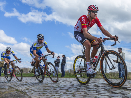 frederik: Hornaing ,France - April 10,2016: The Belgian cyclist Frederik Frison of Lotto-Soudal Team riding in the peloton on a paved road in Hornaing, France during Paris Roubaix on 10 April 2016. Editorial
