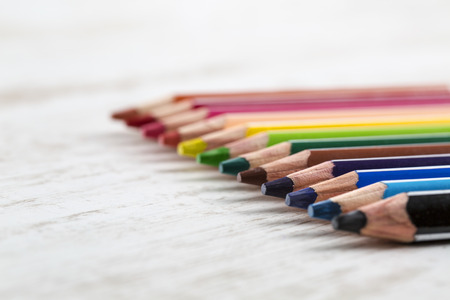 wooden color: Color pencils on a white wooden table  Stock Photo