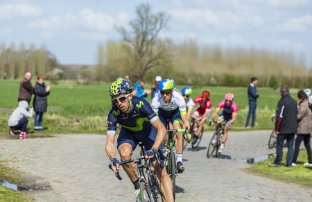 Hornaing ,France - April 10,2016: The Spanish cyclist Imanol Erviti of Movistar Team riding in the peloton, on a paved road in Hornaing, France during Paris Roubaix on 10 April 2016.