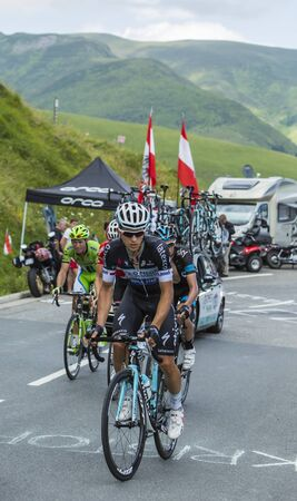 Col de Peyresourde,France- July 23, 2014: The Polish cyclist Michal Kwiatkowski of Omega Pharma�Quick-Step Team riding in the peloton (gruppetto) on the road to Col de Peyresourde in Pyrenees Mountains during the stage 17 of  Le Tour de France on 2
