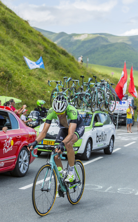le: Col de Peyresourde,France- July 23, 2014: The Belgian cyclist Maarten Wynants (Team Belkin) climbing the road to Col de Peyresourde in Pyrenees Mountains during the stage 17 of Le Tour de France on 23 July 2014.