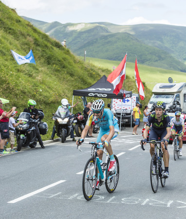 Col de Peyresourde,France- July 23, 2014: Two cyclists, Alessandro Vanotti of Astana Team and Imanol Erviti Ollo of Movistar Team, climbing the road to Col de Peyresourde in Pyrenees Mountains during the stage 17 of Le Tour de France on 23 July 2014. Editorial