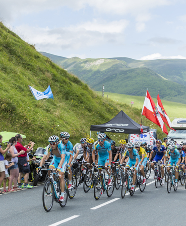 Col de Peyresourde,France- July 23, 2014: Team Astana in front of the peloton climbing the road to Col de Peyresourde in Pyrenees Mountains during the stage 17 of  Le Tour de France on 23 July 2014.