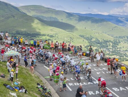peloton: Col de Peyresourde,France- July 23, 2014: The peloton climbing the road to Col de Peyresourde in Pyrenees Mountains during the stage 17 of  Le Tour de France on 23 July 2014. Editorial