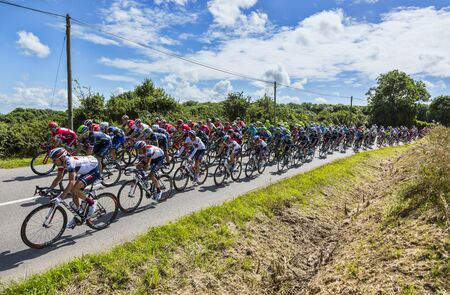 peloton: Quineville,France- July 2, 2016: The peloton riding during the first stage of Tour de France in Quineville, France on July 2, 2016.