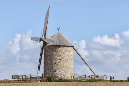 vicinity: Traditional windmill in the vicinity of Mont Saint Michel monastery in Base Normandy in France.This is Le Moulin Moidrey.
