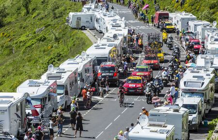 Pas de Peyrol, France - July 6,2016: The cyclists Thomas De Gend of  Lotto-Soudal Team and Greg Van Avermaet of BMC Racing Team, in the breakaway, riding on the road to Pas de Pyerol (Puy Mary) in Cantal,in the Central Massif, during the stage 5 of Tour d
