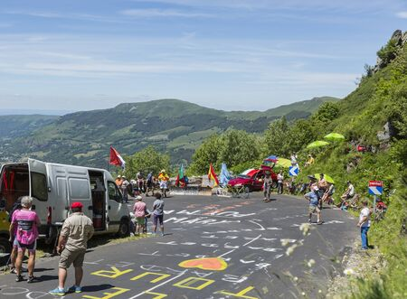 Pas de Peyrol, France - July 6,2016: Spectators and fans waiting for the cyclists on the road to Pas de Pyerol (Puy Mary) in Cantal, in the Central Massif, during the stage 5 of Tour de France on July 6, 2016 .