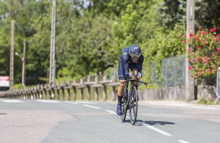 race for time: Bourgoin-Jallieu, France - 07, May, 2017: The Spanish cyclist Alejandro Valverde of Movistar Team riding during the time trial stage 4 of Criterium du Dauphine 2017. Valverde is a strong contender for the final podium of the race.
