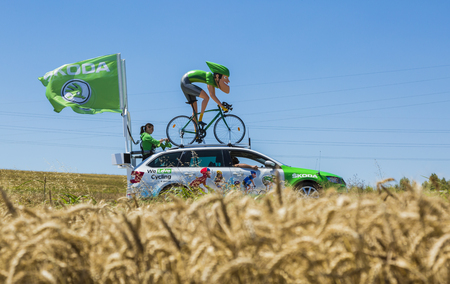 Saint-Quentin-Fallavier, France - July 16, 2016: The sprinter mascot of Skoda during the passing of Publicity Caravan in a wheat plain in the stage 14 of Tour de France 2016. Skoda provides the official car of the competition and it sponsors The Green Jer