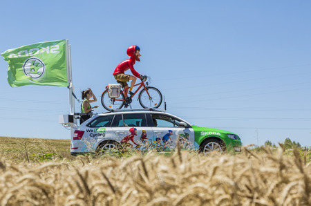 Saint-Quentin-Fallavier, France - July 16, 2016: The globetrotter mascot of Skoda during the passing of Publicity Caravan in a wheat plain in the stage 14 of Tour de France 2016. Skoda provides the official car of the competition and it sponsors The Green Editorial