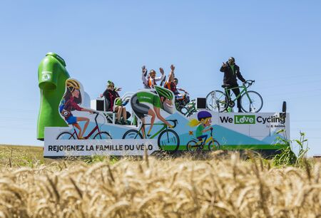 Saint-Quentin-Fallavier, France - July 16, 2016: The truck of Skoda during the passing of Publicity Caravan in a wheat plain in the stage 14 of Tour de France 2016. Skoda provides the official car of the competition and it sponsors The Green Jersey.